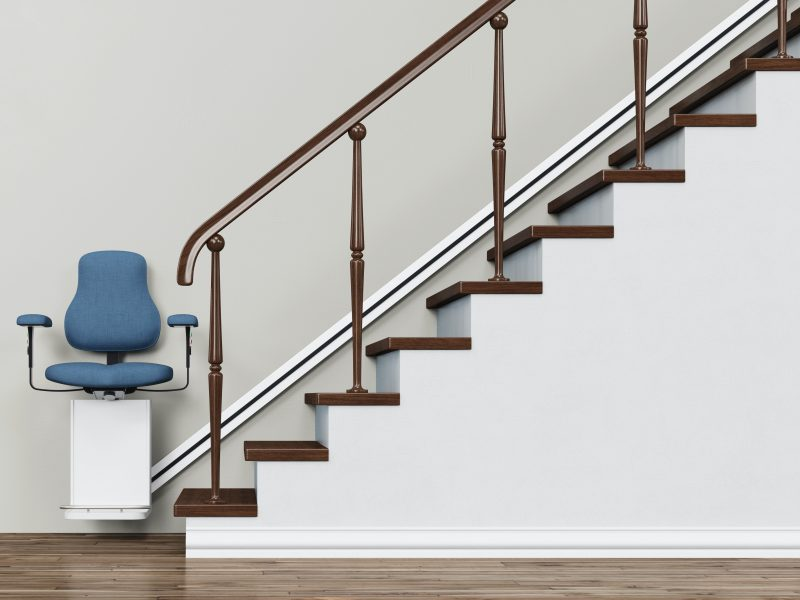Stairlift on a staircase for accessible housing (3D Rendering)